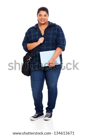 full length of female overweight university student holding text book on white background