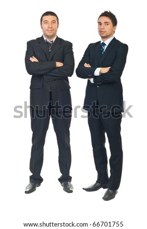 Full length of handsome two business men standing with arms folded isolated on white background - stock photo