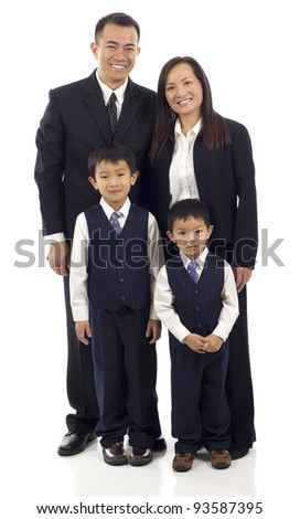 Full length of happy Asian family of four standing isolated over white background