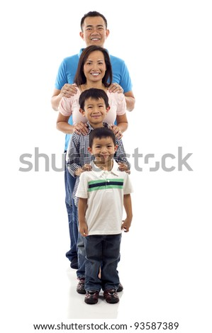 Full length of happy Asian family standing together in line isolated over white background