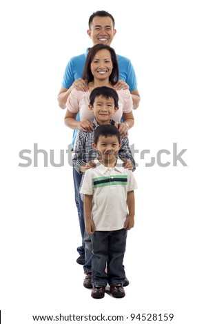 Full length of happy Asian family standing together in line isolated over white background - stock photo