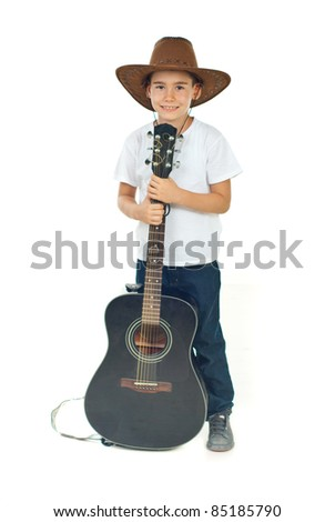 Full length of happy boy wearing cowboy hat and classic guitar against white background - stock photo