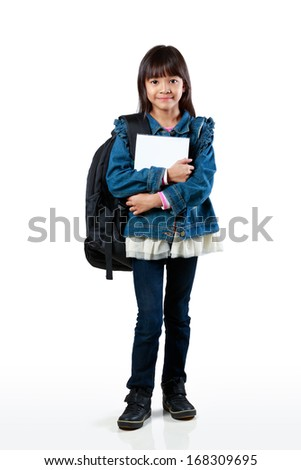 Full length of little asian girl standing and holding books, Isolated over white - stock photo