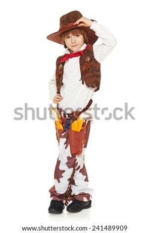 Full length of little boy in a suit of the cowboy welcoming uplifting his hat, on a white background - stock photo