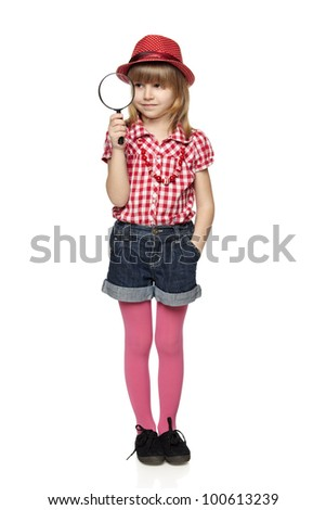 Full length of little girl with magnifying glass, isolated on a white background - stock photo