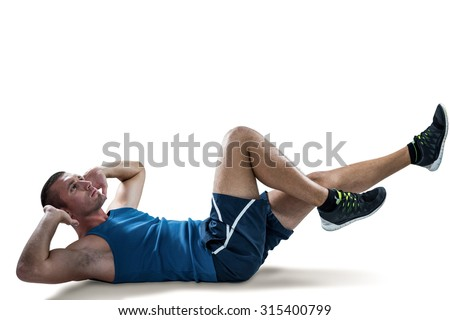 Full length of man doing tummy crunches against white black - stock photo