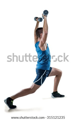 Full length of man in sportswear exercising with dumbbells against white background - stock photo