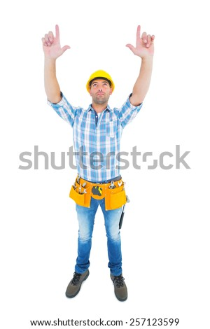 Full length of manual worker forming hand frame while looking up on white background - stock photo