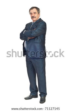 Full length of mature elegant business man standing with arms folded isolated on white background - stock photo