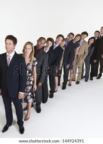Full length of multiethnic businesspeople in a row against white background