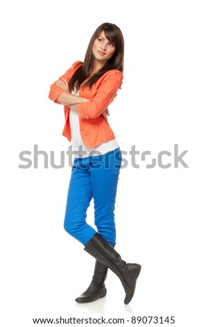 Full length of pensive young female looking up  into the corner at a copy space over white background - stock photo