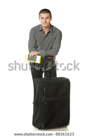 Full length of relaxed businessman leaning on his baggage ready for departure, isolated on white background - stock photo