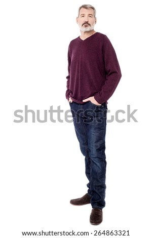 Full length of senior man with hands in pockets