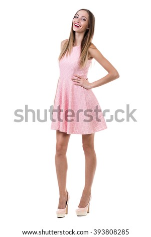 Full length of sensual woman in short dress dancing against isolated white
