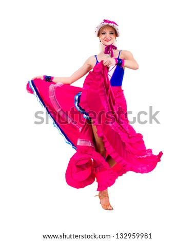 Full length of  sensual woman in short dress dancing against isolated white background
