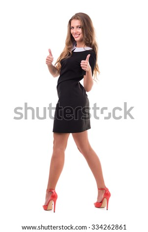 Full length of sensual woman in short dress posing against isolated white background