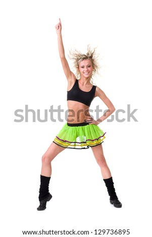 Full length of  sensual woman in short skirt dancing against isolated white background - stock photo
