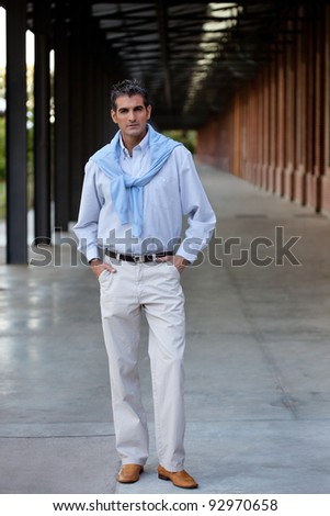 Full length of smart middle aged man standing with hands in pocket - stock photo