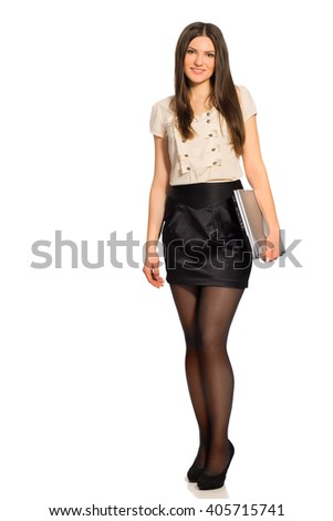 Full length of smiling pretty woman with closed laptop isolated on white background