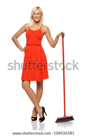 Full length of smiling woman standing with broom, looking to the side, isolated on white background - stock photo