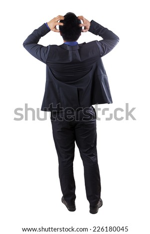 Full length of stressful businessman standing in studio, isolated on white background - stock photo