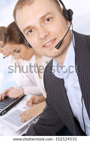 Full length of successful male customer service representative - stock photo