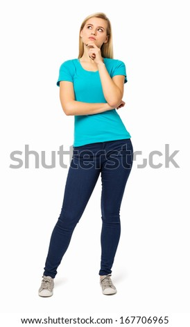 Full length of thoughtful woman with hand on chin standing against white background. Vertical shot. - stock photo