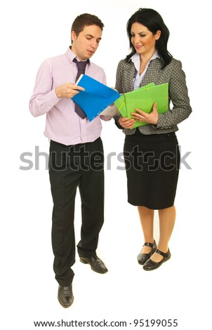 Full length of two business people looking on contracts and having conversation isolated on white background - stock photo