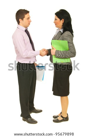 Full length of two business people shaking hands and holding folders isolated on white background - stock photo
