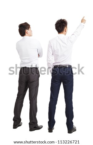 full length of two businessman pointing and looking - stock photo