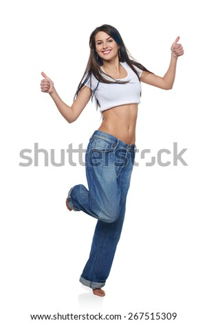 Full length of woman giving an enthusiastic thumb's up, on white background - stock photo