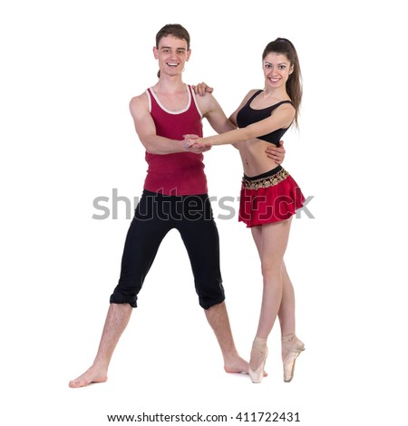Full length of young ballet couple dancing on white background - stock photo