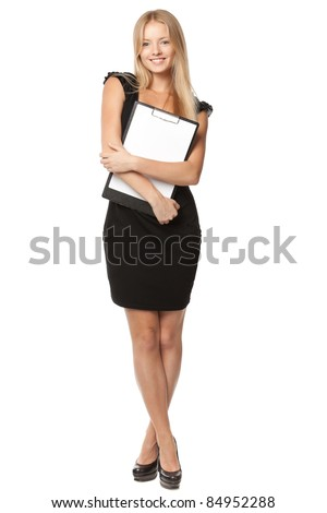 Full length of young blond business woman holding clipboard over white background - stock photo
