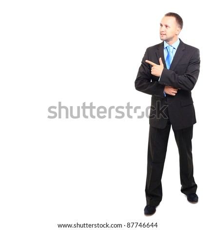 Full length of young business man pointing to copy space isolated on white background - stock photo