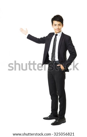 full length of young business man presenting something - stock photo