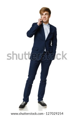 Full length of young business man talking on cellphone, over white background