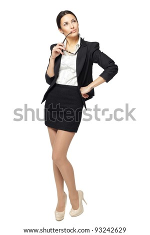 Full length of young business woman looking upwards, isolated on white background - stock photo