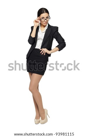 Full length of young business woman standing, isolated on white background