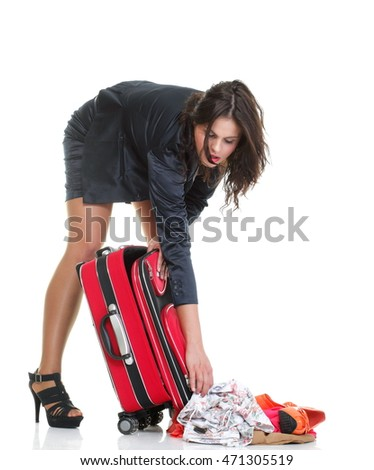 Full length of young business woman to late mishap misadventure pulling red travel bag clock isolated on white background