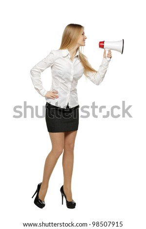 Full length of young business woman with megaphone, over white background - stock photo