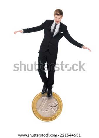 Full length of young businessman balancing on one euro coin over white background - stock photo