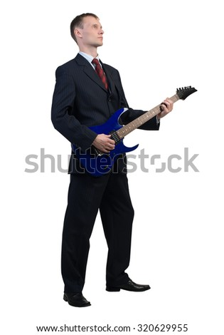 Full length of young businessman playing guitar on white background - stock photo