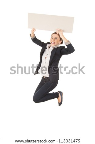 full length of young businesswoman jumping with blank empty billboard or placard, white background - stock photo
