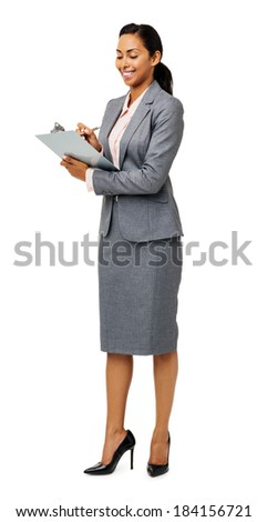 Full length of young businesswoman writing on clipboard against white background. Vertical shot. - stock photo