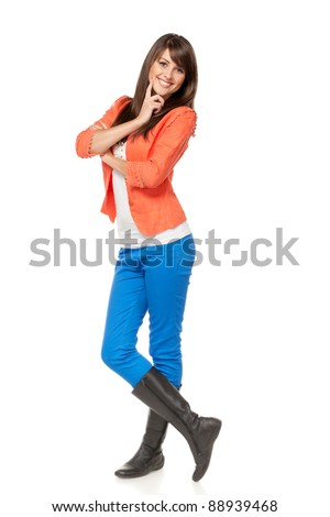 Full length of young charming female posing over white background - stock photo