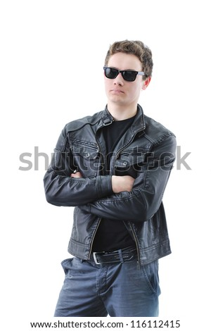 Full length of young confident man standing with hands folded isolated on white - stock photo