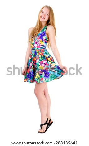 Full length of young cute smile girl stands on tiptoe in summer dress posing isolated on white background, positive human emotion, facial expression - stock photo