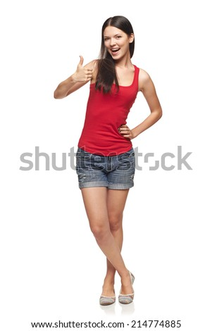 Full length of young cute smiling emotional girl giving you thumb up, isolated on white - stock photo