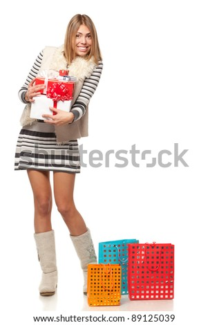 Full length of young female holding a heap of gifts, isolated on white background