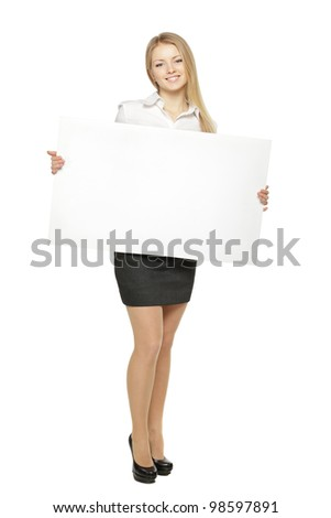 Full length of young female holding the blank board isolated on white background